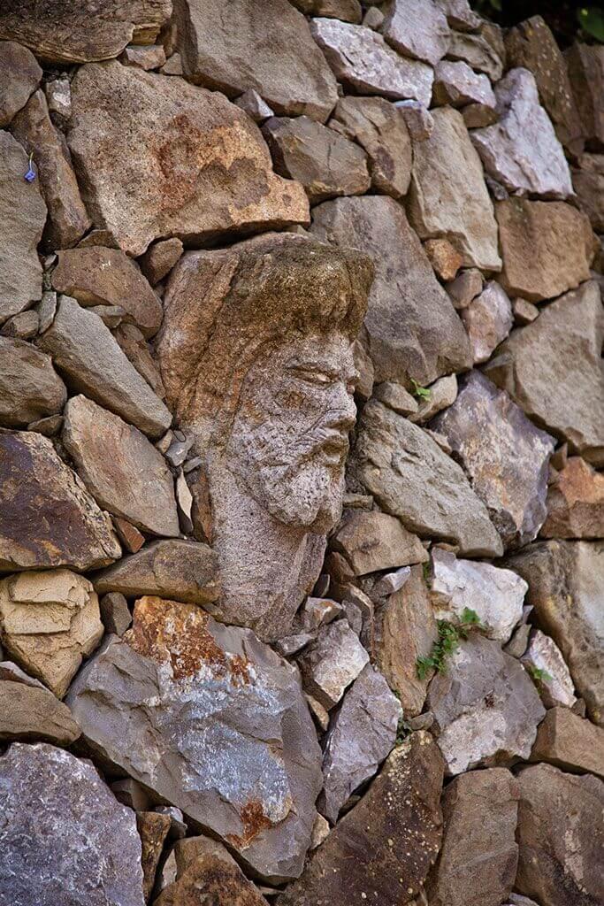 stone faces in the garden